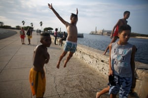Alberto Echeverria, 16, jumps around with his friends at the Malecón seawall in Havana, Cuba.