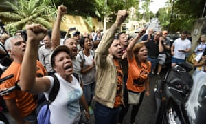 Supporters of Leopoldo Lopez gather outside his house in Caracas, after he was released from prison and placed under house arrest.