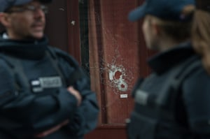 Windows of Carillon and Cambodian restaurant are shattered by bullet holes, in Paris