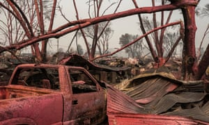 Red fire retardant smothers homes destroyed by the Almeda Fire in Talent, Oregon.