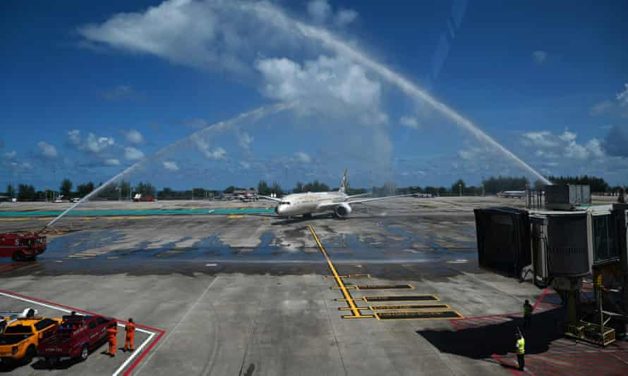 Celebratory sprays of water are prepared for an Etihad Airways plane arriving from Abu Dhabi carrying passengers for the Phuket Sandbox tourism scheme.