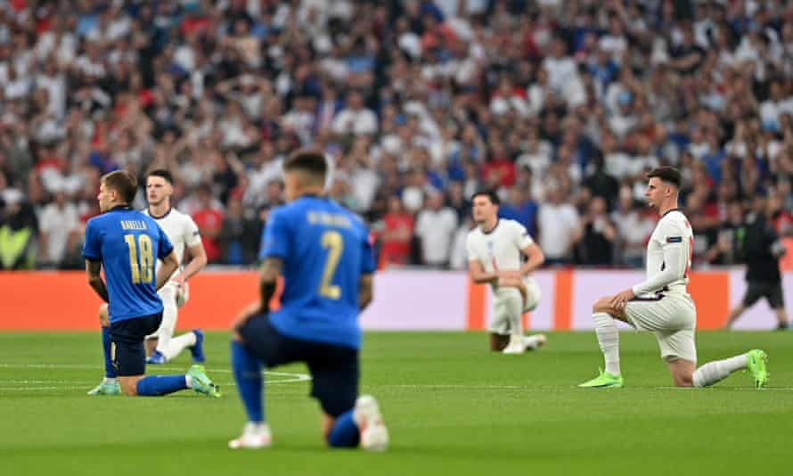 England and Italy players take the knee before Sunday's Euro 2020 final.
