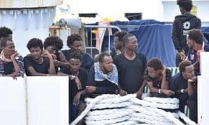 Migrants on the ship in the port of Catania