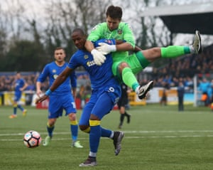 AFC Wimbledon's Tom Elliott and Sutton's keeper Ross Worner clash during the 0-0 draw