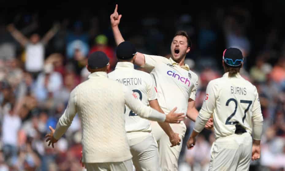 England's Ollie Robinson celebrates after taking the wicket of India captain Virat Kohli.