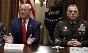 Donald Trump with Mark Milley, the chairman of the joint chiefs of staff, in the Cabinet Room on Monday. Lindsey Graham said abandoning the Kurds would be 'a stain on America's honour'.