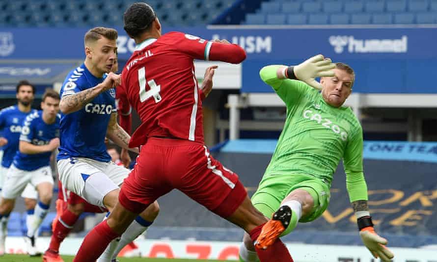 Virgil van Dijk is injured by Everton's Jordan Pickford during Saturday's derby