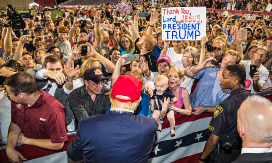 Donald Trump and supporters at a 2015 Republican rally