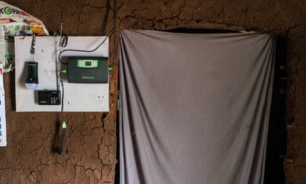 Control unit fixed to a mud wall in a home powered by M-Kopa solar technology in a village in Kenya