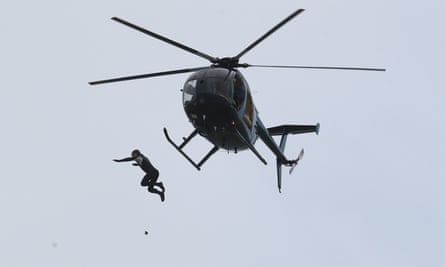 John Bream leaping from a helicopter