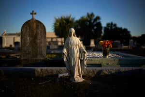 Before he was arrested on drug charges, Adrian Caliste would often sleep on his mother's grave at Mount Olivet Cemetery in New Orleans, Louisiana.
