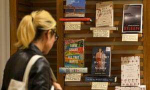 A woman looks at Man Booker prize 2016 shortlisted books at a Waterstones branch.