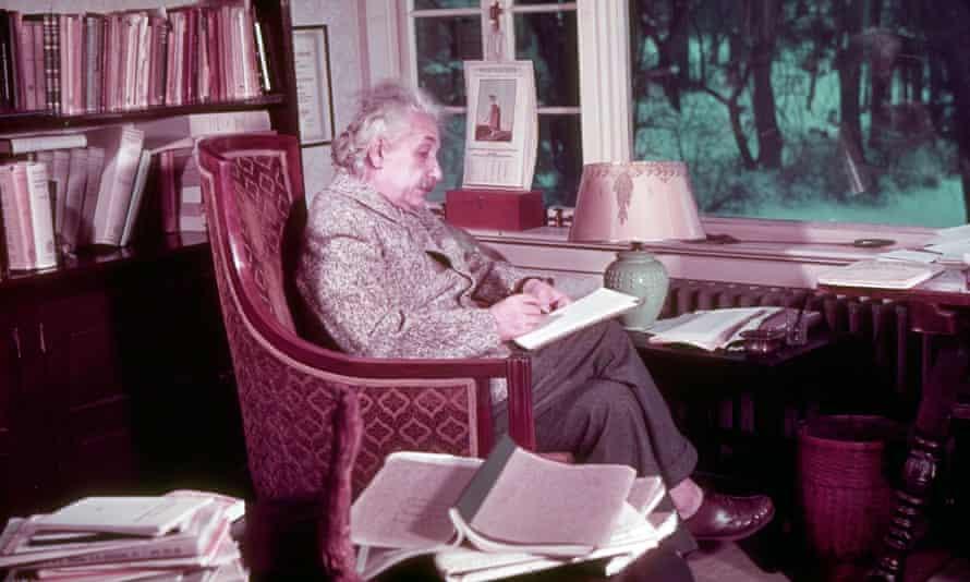 Albert Einstein at work in his study.