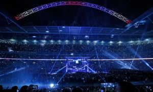 Wembley Stadium is lit up by spotlights and thousands of mobile phones as Anthony Joshua makes his ring-walk before his world heavyweight unification title fight against Wladimir Klitschko.