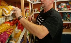Man stocking shelves at a food bank