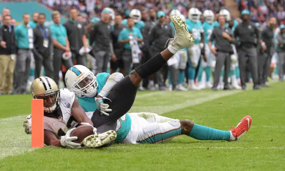 New Orleans Saints wide receiver Michael Thomas scores a touchdown despite the attentions of Miami Dolphins cornerback Cordrea Tankersley at Wembley Stadium on Sunday.