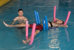 Vardy floats in the pool with the FA physiotherapist. The Leicester striker was on the bench for the match against Sweden with a groin injury.