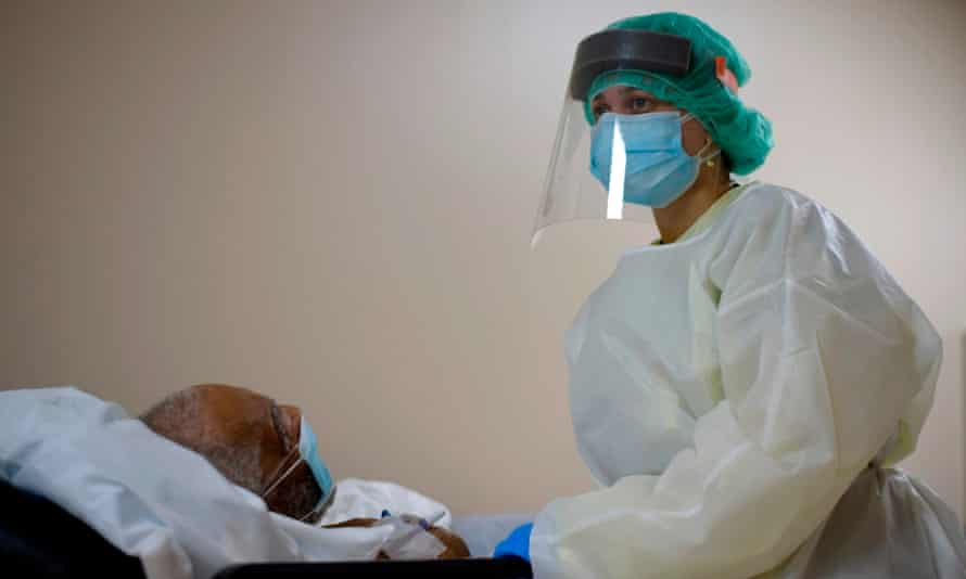 A healthcare worker tends to a patient in the Covid-19 Unit at United Memorial Medical Center in Houston, Texas.
