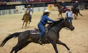 Pennie Brown of Cowgirls of Color gathers speed during the barrel relay