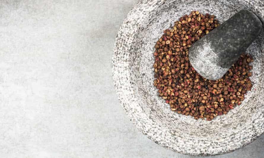 Szechuan pepper seeds in a mortar and pestle