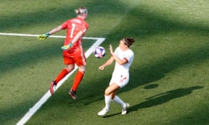 Sweden's Hedvig Lindahl beats England's Jodie Taylor to the ball.