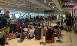 Stranded passengers queue outside the Emirates customer service office in Denpasar airport, Bali, on Monday. The UK has called for all its citizens to return home immediately due to the coronavirus outbreak.