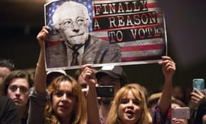 Bernie Sanders supporters hold a sign in Los Angeles during the 2016 election campaign.