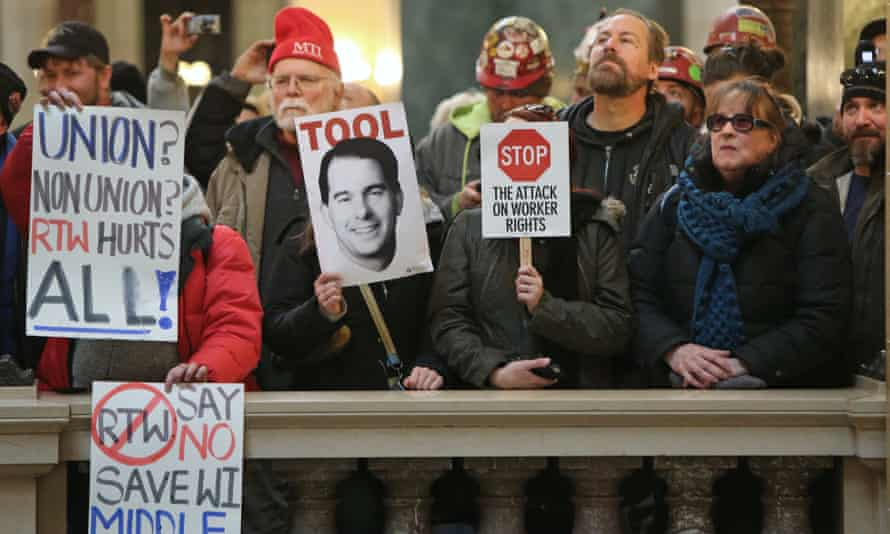 A crowd protests outside the Senate during an extraordinary session on the right-to-work bill at the Wisconsin State Capitol in Madison, Wis., Wednesday, Feb. 25, 2015. (AP Photo/Wisconsin State Journal, Amber Arnold)