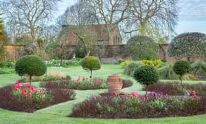 The walled garden at Rymans: a perfect balance of specimen trees, flowering shrubs, immaculate topiary and generous herbaceous borders set among lawns