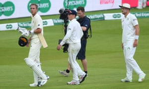 Due to a thunder and lightning warning the players, including Ireland captain William Porterfield (centre), head off the pitch and England batsman Stuart Broad looks at the sky as he walks to the dressing room.