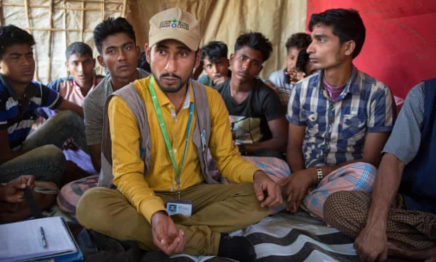 Imrul Hosen leads a counselling session at the Balukali camp.