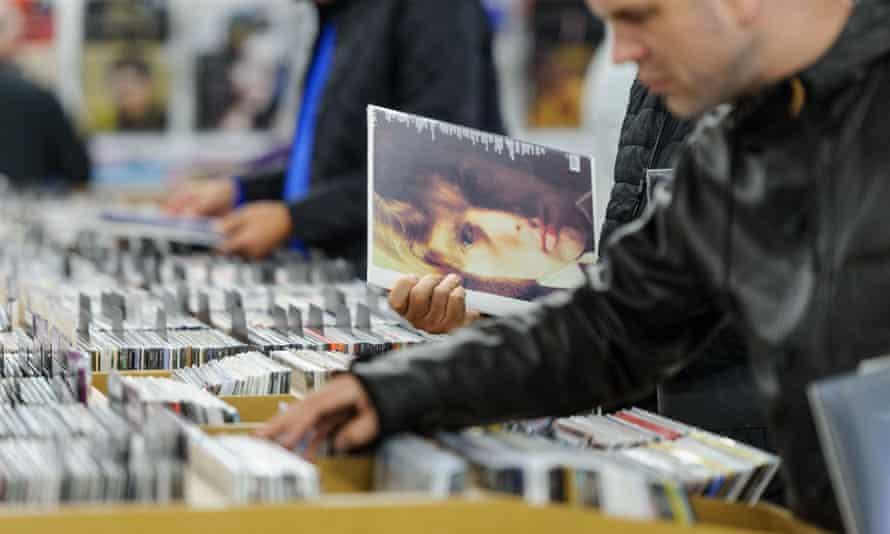 man looking through vinyl albums in a shop