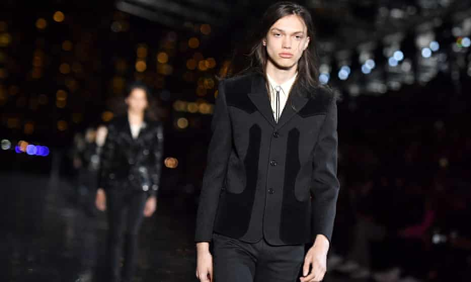 A model in a black jacket at the Saint Laurent show