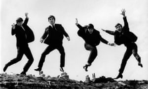 Photo of BEATLES<br>UNITED KINGDOM - APRIL 01: Photo of BEATLES; L-R: Ringo Starr, George Harrison, Paul McCartney, John Lennon - posed, group shot - jumping on wall, Used on the Twist &amp; Shout EP cover (Photo by Fiona Adams/Redferns)