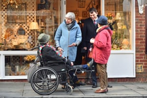 Salisbury, UK: Theresa May talks to bystanders during a walkabout with the local MP John Glen