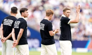 England players including captain Joe Root (right) line up wearing t-shirts campaigning against various discriminations.