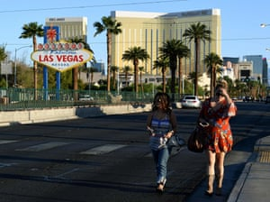 Two women walk away from the scene of the Las Vegas shooting