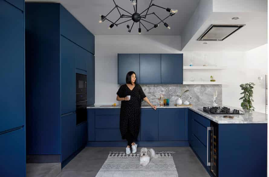 Sharon Toong in her kitchen with dark blue units