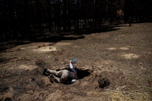 John Creighton, the founder of Wombat Care Bundanoon, looks for traces of wombats in a burrow in a burnt-out forest in New South Wales, Australia. Australians are being asked to join a mass citizen science programme to photograph how the nation's habitats and wildlife are responding in the wake of the unprecedented bushfire crisis