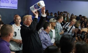 Donald TrumpPresident Donald Trump tosses paper towels into a crowd as he hands out supplies at Calvary Chapel, Tuesday, Oct. 3, 2017, in Guaynabo, Puerto Rico. Trump is in Puerto Rico to survey hurricane damage. (AP Photo/Evan Vucci)