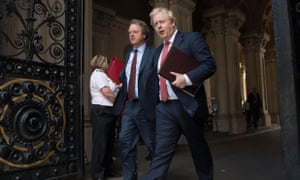 Boris Johnson (right) leaves the Foreign Office in London