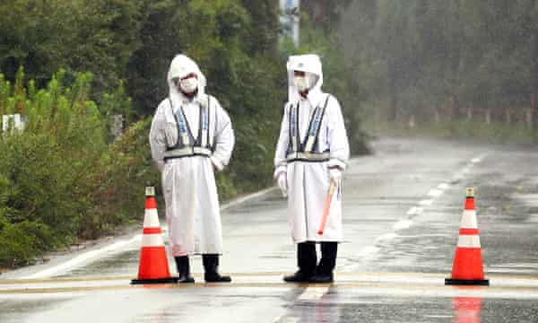 Security staff block a road leading to the crippled Fukushima nuclear plant in Japan. Despite being a nuclear level 7 accident, no one has died as a result of radioactive discharge.