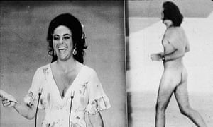 Elizabeth Taylor laughs after being upstaged by streaker Robert Opal at the 1974 Oscars.