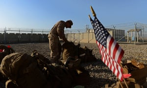 """A US Marine arranges his equipment as British and US troops withdraw from the Camp Bastion-Leatherneck complex at Lashkar Gah in Afghanistan's Helmand province. Kabul welcomed the US decision to keep thousands of troops in Afghanistan past 2016, vowing to respond to a resurgent Taliban """"with full force"""" even as the rebels promised to wage jihad until the last American soldier leaves. AFP PHOTO / WAKIL KOHSAR / FILESWAKIL KOHSAR/AFP/Getty Images"""