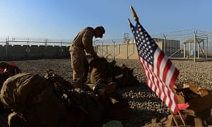 In a file photograph from 2014, a US marine arranges his equipment at the former US-British military base in Helmand province now known as Camp Shorab.