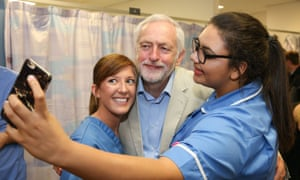 Jeremy Corbyn poses for a photo for nursing staff during a visit to the Royal Stoke University Hospital.