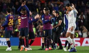 Liverpool's Virgil van Dijk looks dejected whilst Barcelona's players applaud their fans.