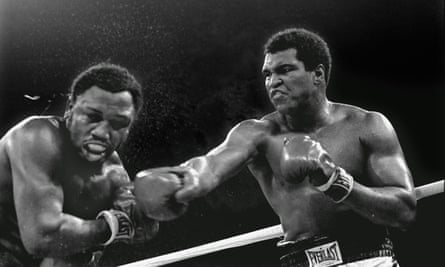 Ali strikes Joe Frazier with a right during the pair's final bout, the Thrilla in Manila in 1975.