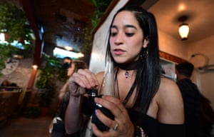 Erika Soto holds a dabbing device