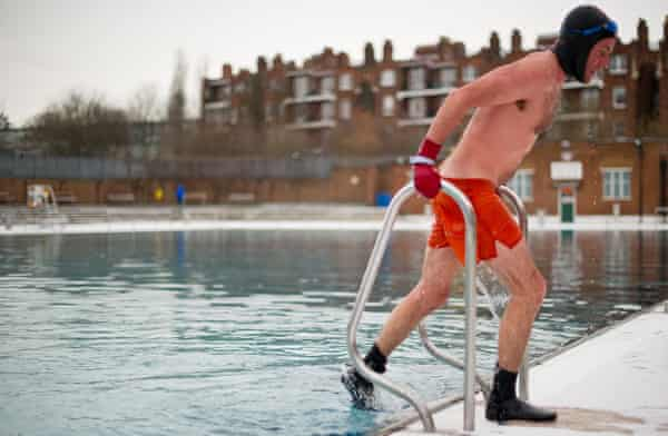 A swimmer braves the cold at Parliament Hill lido in mid-winter.